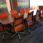 conference-table-orange-chairs